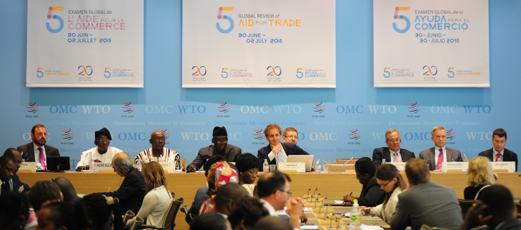 Adam Sneyd moderating a plenary @ the WTO